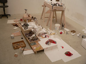 Kathryn Spence, Work in progress in studio, 2009; Wood, fabric scraps, styrofoam, colored pencil, paper, photographs, nail polish, etc. Dimensions variable