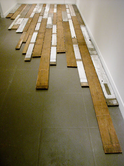 Jess Schlesinger. 100 ton line. Dimensions: variable. Material: Found and personally reclaimed lumber. installation at ProArts in Oakland, 2008
