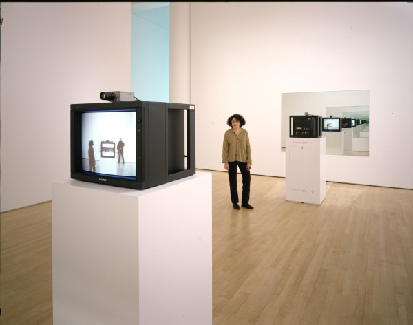 Dan Graham, Opposing Mirrors and Video Monitors on Time Delay, 1974/1993; video installation; two mirrors, two cameras, two monitors, time delay, 360 in. x 360 in. (914.4 cm x 914.4 cm); Collection SFMOMA, Gift of Dare and Themis Michos and Accessions Committee Fund purchase: gift of Collectors Forum, Doris and Donald Fisher, Evelyn and Walter Haas, Jr., Pamela and Richard Kramlich, Leanne B. Roberts, Madeleine H. Russell, and Helen and Charles Schwab; © Dan Graham