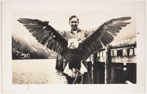 Unknown, Untitled [Man holding eagle with spread wings], n.d.