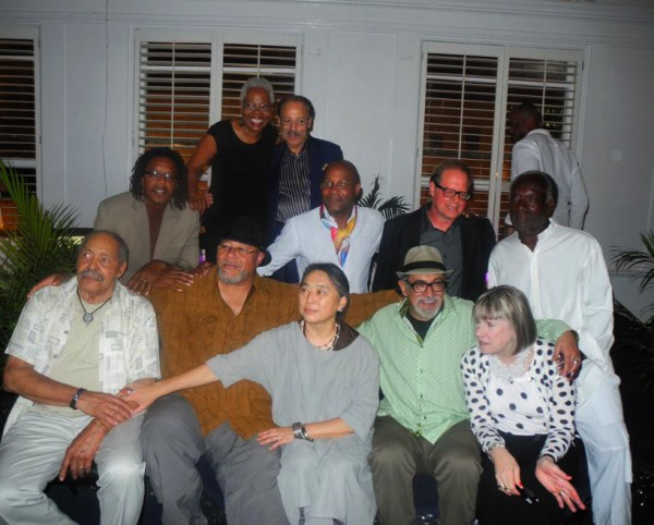 In back, 3rd; Joyce Gordon and Ed Dwight (sculptor NOT IN THE SHOW) (Left to Right) In the middle row is; Michael Chukes (sculptor), Stevens Jay Carter (painter and mix media artist), David Ruth (Glass sculptor), Raymond Saunders (painter ARTWOK NOT IN SHOW) 1st row; Richard Mayhew (painter), Dewey Crumpler (painter and mix media artist), Hung Liu (painter) Enrique Chagoya (painter), Squeak Carnwath) (painter) Photo: by Ashley Chamber - Oakland Post