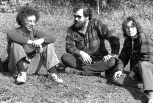 Dennis Leon, Joe Girard and Stephen Ajay sitting near _Vacant Lot Piece_, 1976; © Estate of Dennis Leon