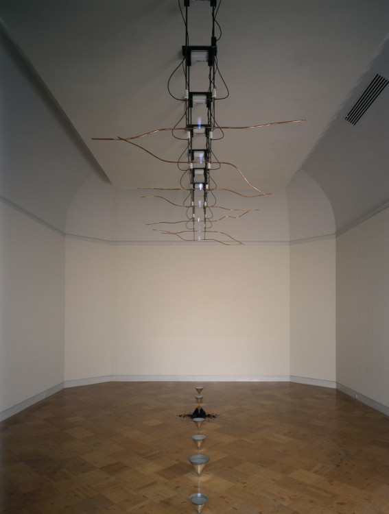 Rebecca Horn, The Hydra-Forest: Performing Oscar Wilde, 1988; electrical devices, glass, mercury, coal, and shoes, 160 in. x 250 in. x 450 in. (406.4 cm x 635 cm x 1143 cm); Collection SFMOMA, Accessions Committee Fund: gift of Frances and John G. Bowes, Evelyn and Walter Haas Jr., Mr. and Mrs. Robert I. MacDonnell, Helen O'Neill Schwab, and Mrs. Paul Wattis; bequest of Grace McCann Morley; the Doris and Donald Fisher Fund; and the Anne Marie; © Artists Rights Society (ARS), New York / Beeldrecht, Amsterdam