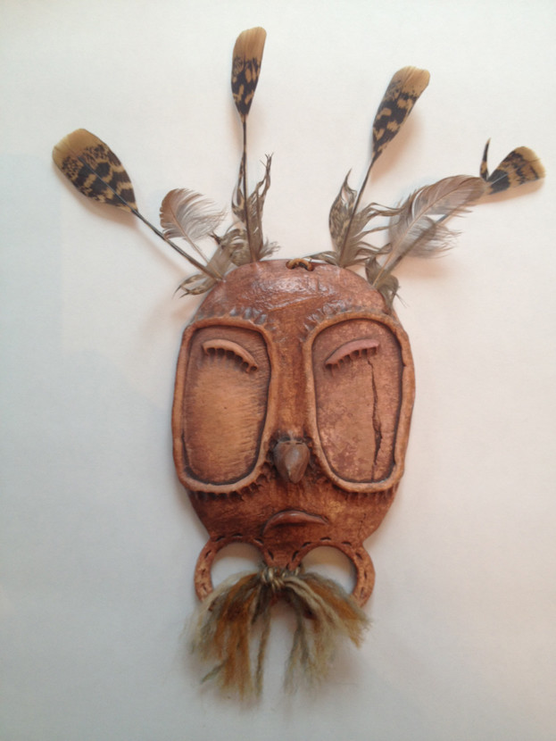 Jeanne Johnson (1950 - 2016). Yup'ik Mask; clay, feather, fingerprints, yarn.