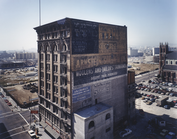 Janet Delaney, Mercantile Building, c. 1903, with a view toward the Moscone Center construction site, from the series South of Market, 1978-1986, 1980, printed 1998