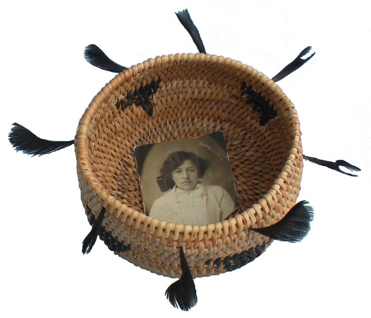 The artist's first traditional basket, ornamented with quail topknot feathers and dedicated to her grandmother Beatrice Barcelone. Photo by Linda Yamane.