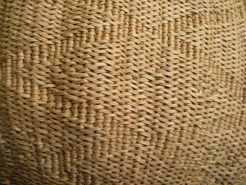 Utilitarian baskets were often made esthetically rich by subtle patterning, as in this seed-roasting basket created by the artist. Photo by Linda Yamane.