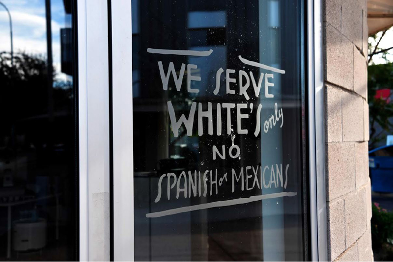 Daniel Ruanova, Old Habits Die Hard III, 2016. Daniel Ruanova's approximation of a racist store sign from 1949 was etched on the window of Tempe, Arizona's Fine Arts Complex in 2016. The piece proved so controversial that the gallery was forced to post a note explaining its artistic intent to stem kneejerk repulsion from passers-by. Photo rights Daniel Ruanova.