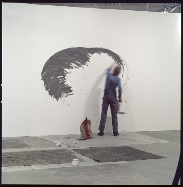 David Ireland making wall work for the exhibition 18 Bay Area Artists, Los Angeles institute of Contemporary Art, 1976; image courtesy of The 500 Capp Street Foundation.