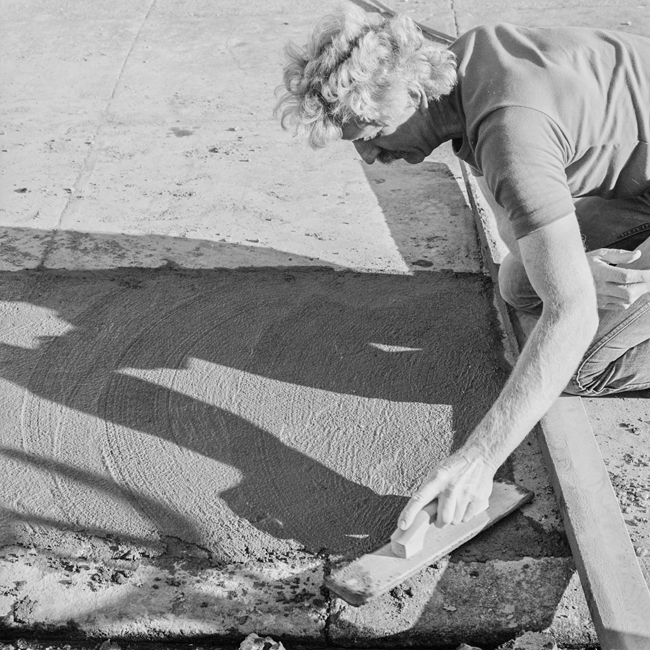David Ireland repairing the sidewalk, 500 Capp Street, 1976; photo: Tom Marioni; image courtesy of The 500 Capp Street Foundation.