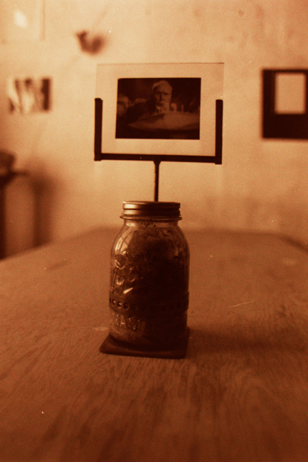 Jar with a slice of cake from Mr. Gordon's ninety-fifth birthday. Daniel Gordon was the last tenant at 500 Capp Street and maintained a close relation to David Ireland after he moved out of the house on Capp street; photo: David Ireland; image courtesy of The 500 Capp Street Foundation.