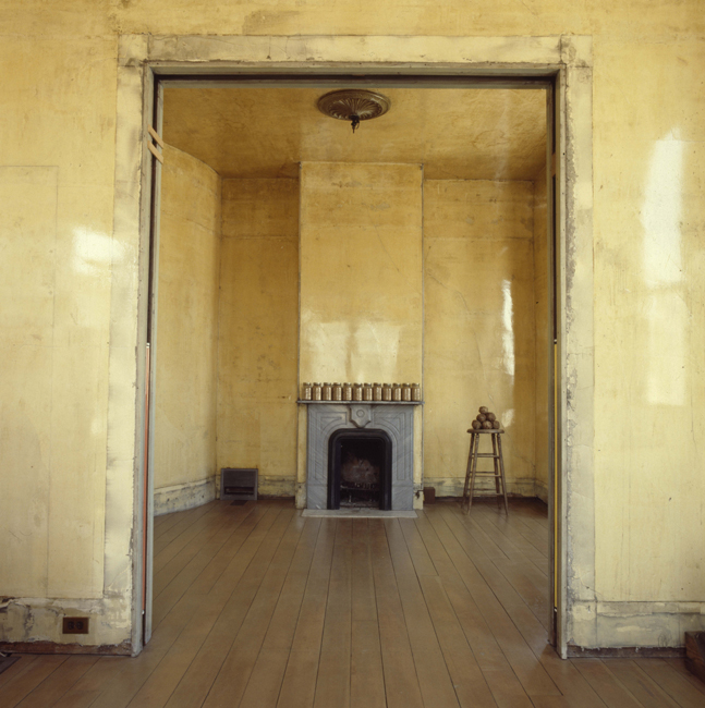 Second level back parlor with jars of sand on the mantel and Elephant Stool (1978), 1978; photo: David Ireland; image courtesy of The 500 Capp Street Foundation.