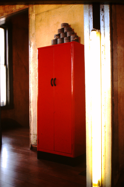 Red cabinet with cans, nd; photo: David Ireland; image courtesy of The 500 Capp Street Foundation.
