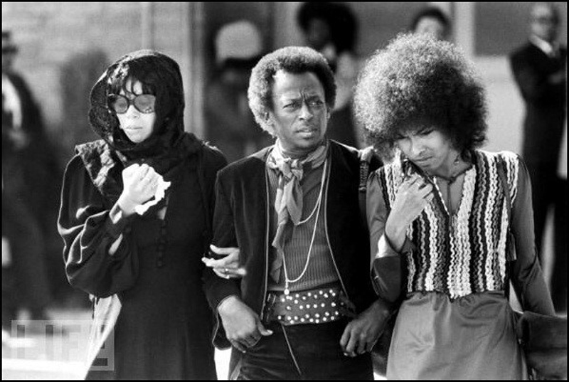 Betty Mabry, Miles Davis, and an unidentified woman attending the funeral of Jimi Hendrix. Photographer unknown.