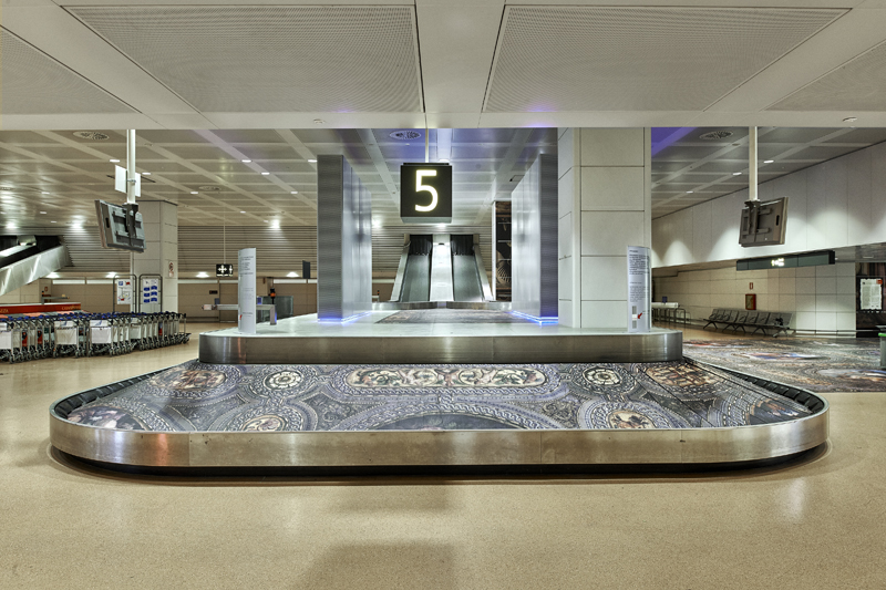Simon Denny, Secret Power, 2015. Installation view, Marco Polo Airport arrivals lounge. Photo: Paolo Monello.