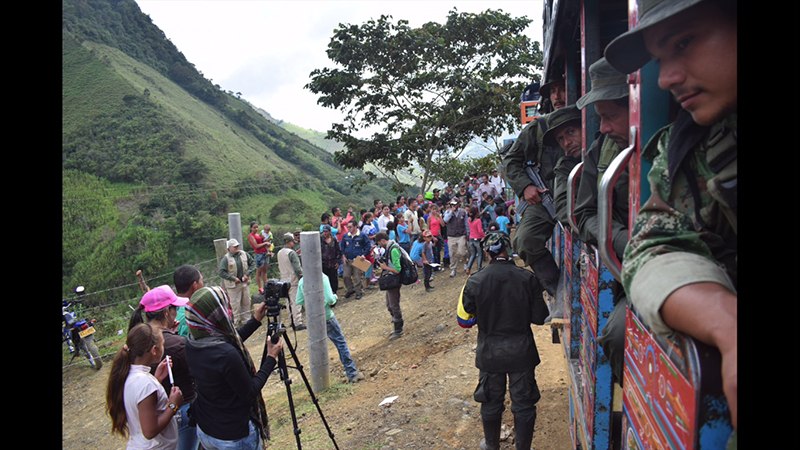 Ex-FARC members in a chiva (local bus) on their way to the vereda Santa Lucía, where they were about to give up their weapons and uniforms before entering the ETCR Román Ruiz. Photo credit: Communications team of the ETCR Román Ruiz.