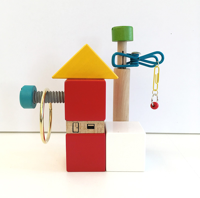 "Casual Learning Environment No. 11, 2018; wood blocks and toys, clip, metal rings, thumb tack, paper clip, 5.75"" x 6"" x 2.5"""