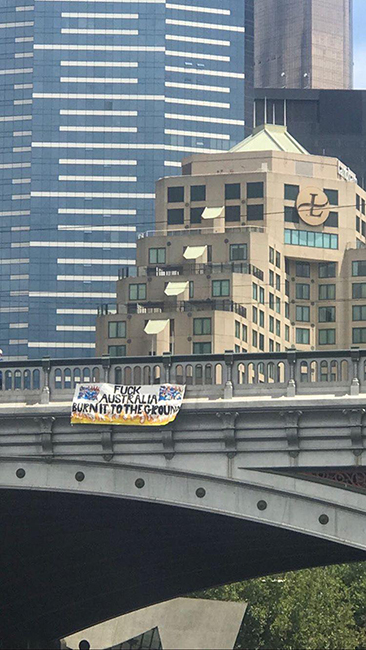 Banner dropped off a bridge in Melbourne.