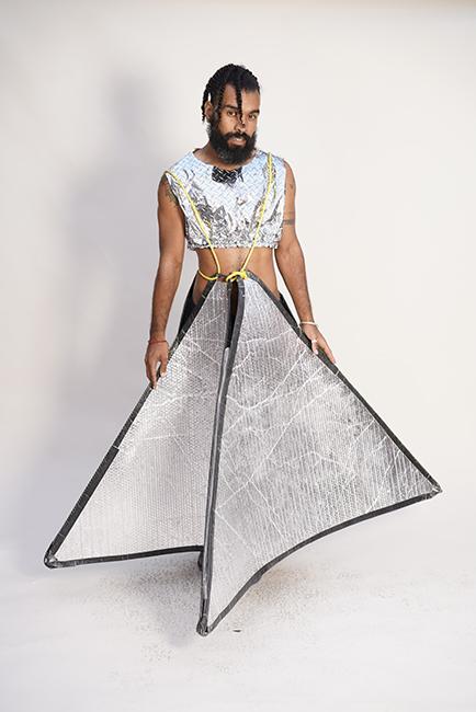 Bonanza, Illuminati Skank Skirt Dress, 2018. Metallic bubble wrap, rope from a children's swing, metallic diamond quilted wrapping paper, elastic. Photo by Graham Holoch.