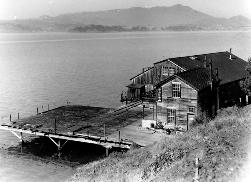 The Codfishery remains at high tide. The bunkhouse is in the foreground. From the Dave Lemon and Jerry O'Day collection, which is housed in the Belvedere-Tiburon Landmarks Society.