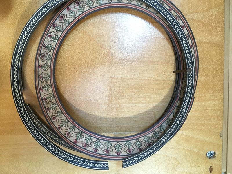 Herringbone design next to a wooden mosaic classical rosette.