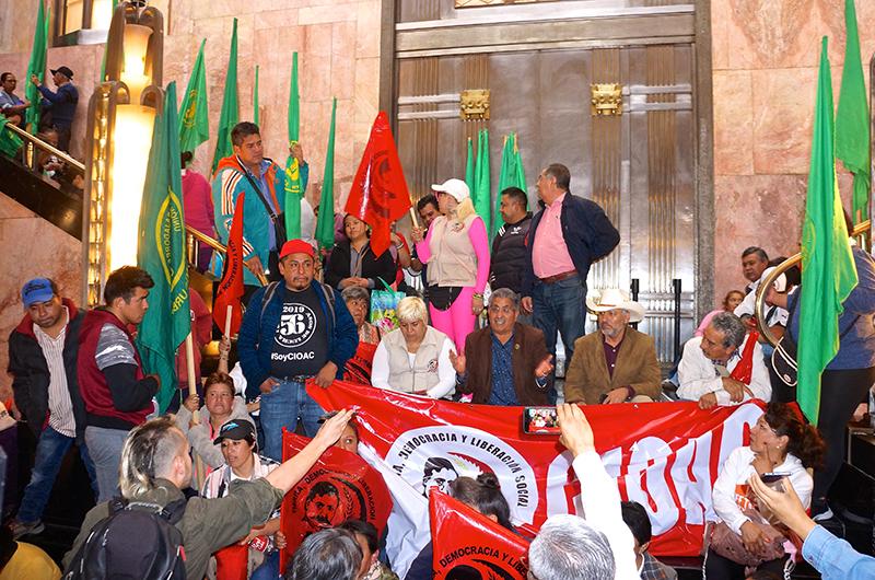 Members of farmworkers associations protest La Revolución at Bellas Artes on December 12, 2019. Photo: Antonio Bertrán.