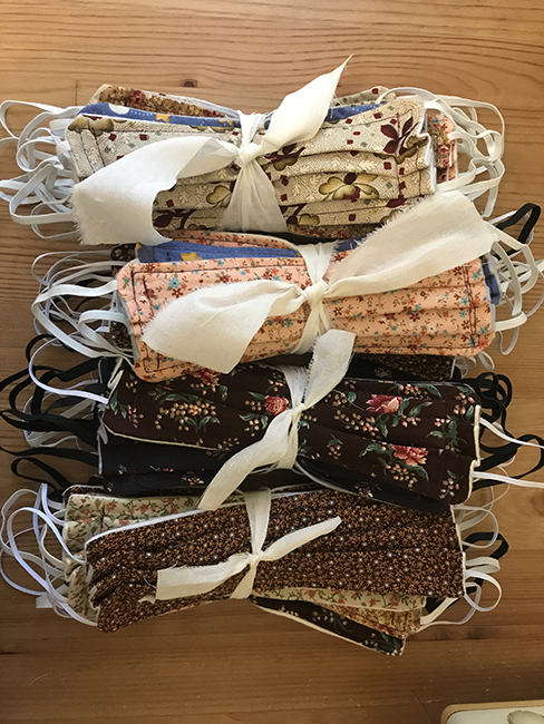 Bundles of masks made from Allison Smith's fabric remnants.