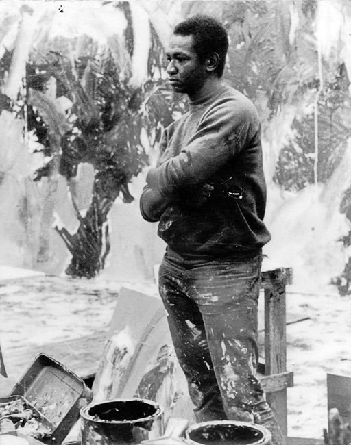 """Mike Henderson ca. 1970s. """"At the SFAI working on the biggest painting I ever did, during Christmas break. Around about two or three in the morning."""" Photo: George Auxier."""
