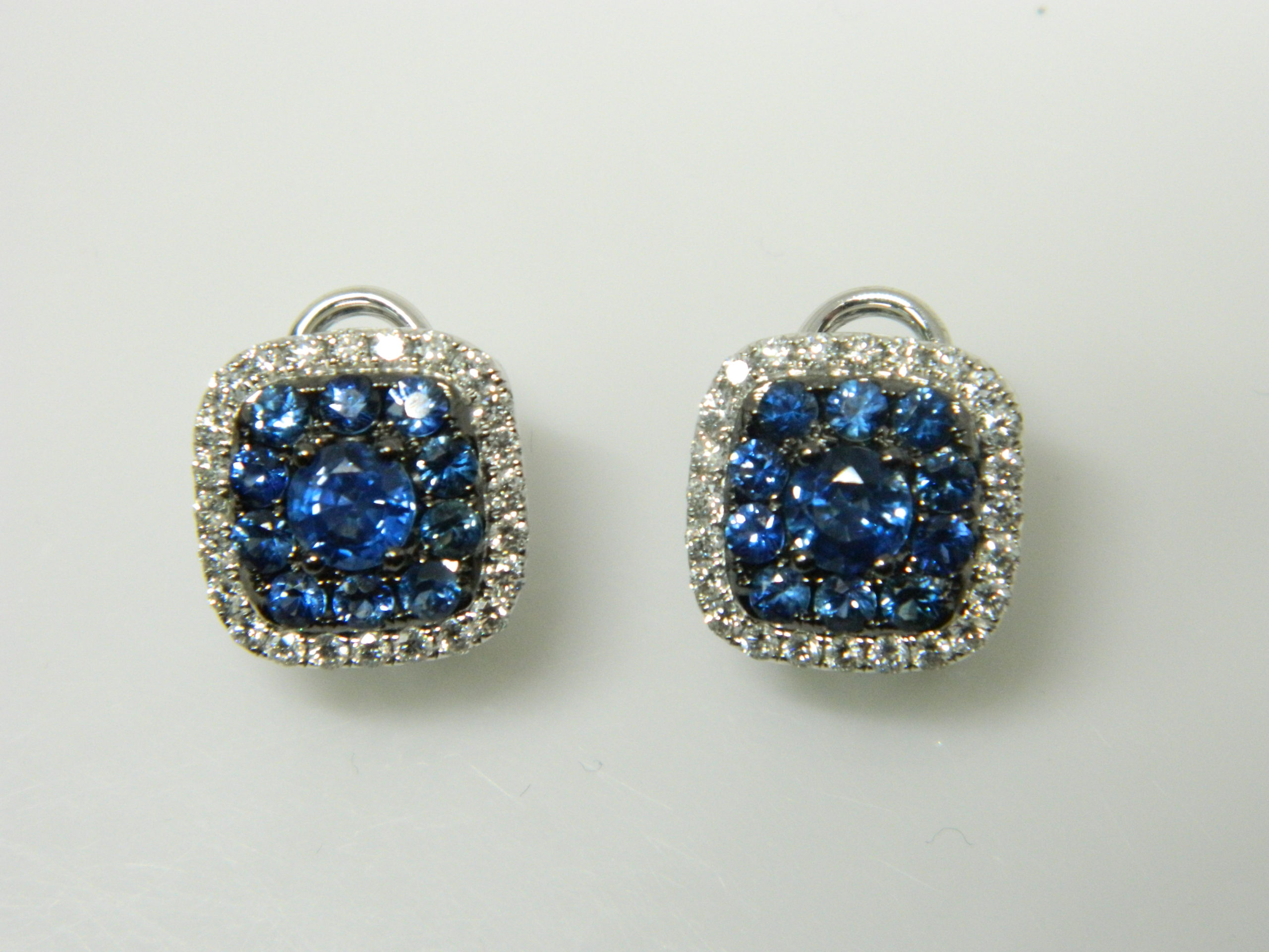 18 Karat White Gold Button Mounted Earrings with 2 Blue Sapphires weighing 1.27cts, 20 Blue Sapphires weighing 1.44cts, 48 Round Cut Diamonds weighing 0.84cts