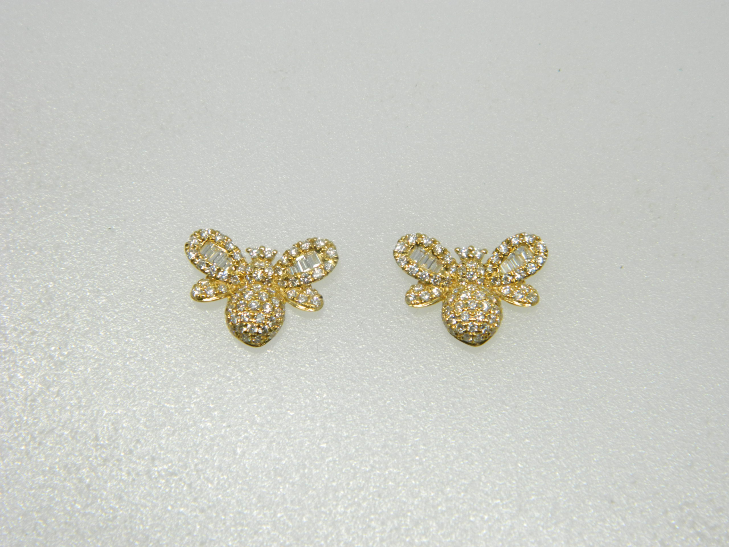 18 Karat Yellow Gold Stud Mounted Bee Earrings with 12 Baguette Cut Diamonds weighing 0.13cts & 142 Round Cut Diamonds weighing 0.52cts
