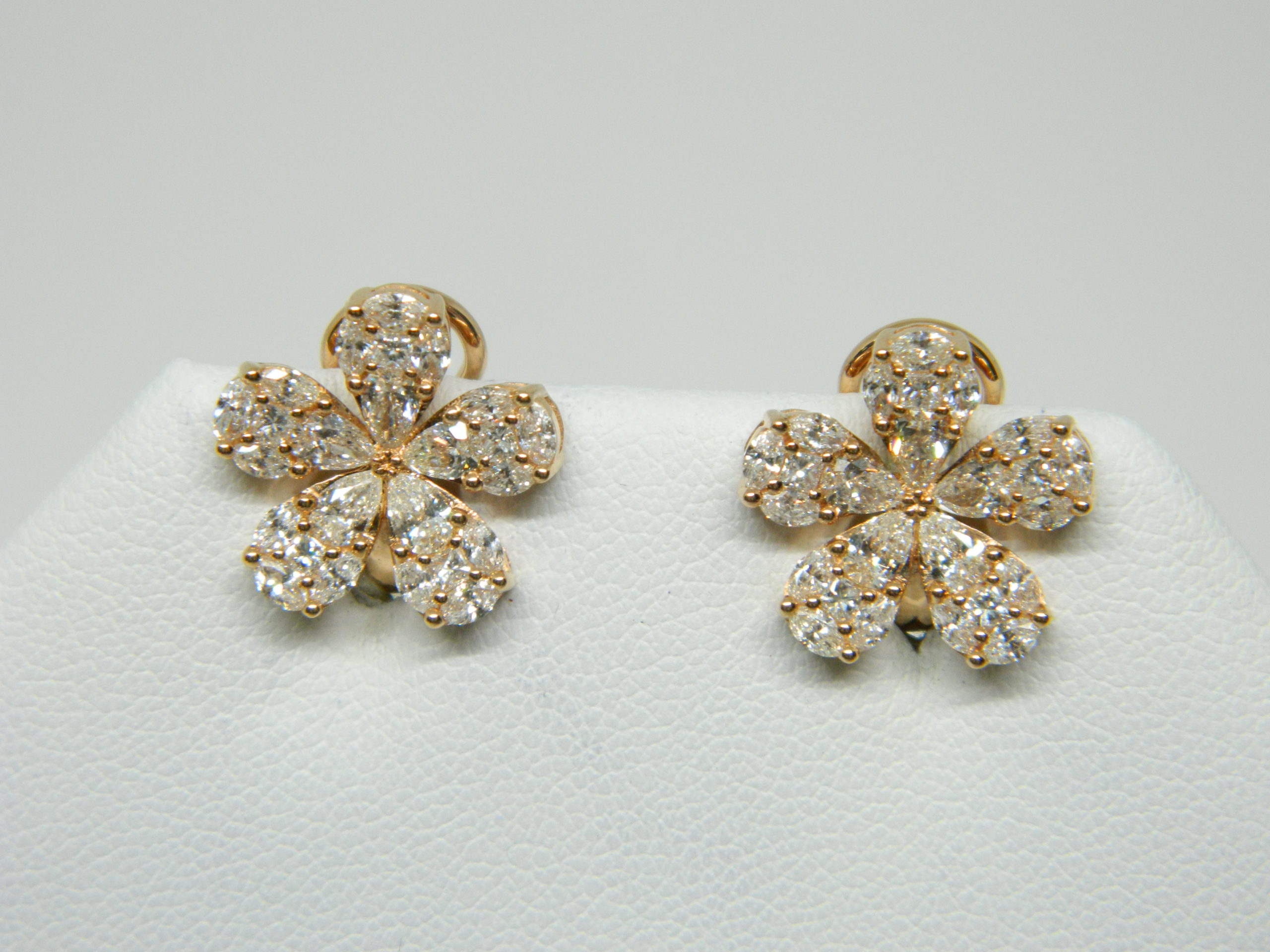 18 Karat Rose Gold Button Mounted Earrings 10 Pear Cut Diamonds weighing 0.87cts, 30 Marquise Cut Diamonds weighing 0.91cts, 10 Princess Cut Diamonds weighing 0.28cts.