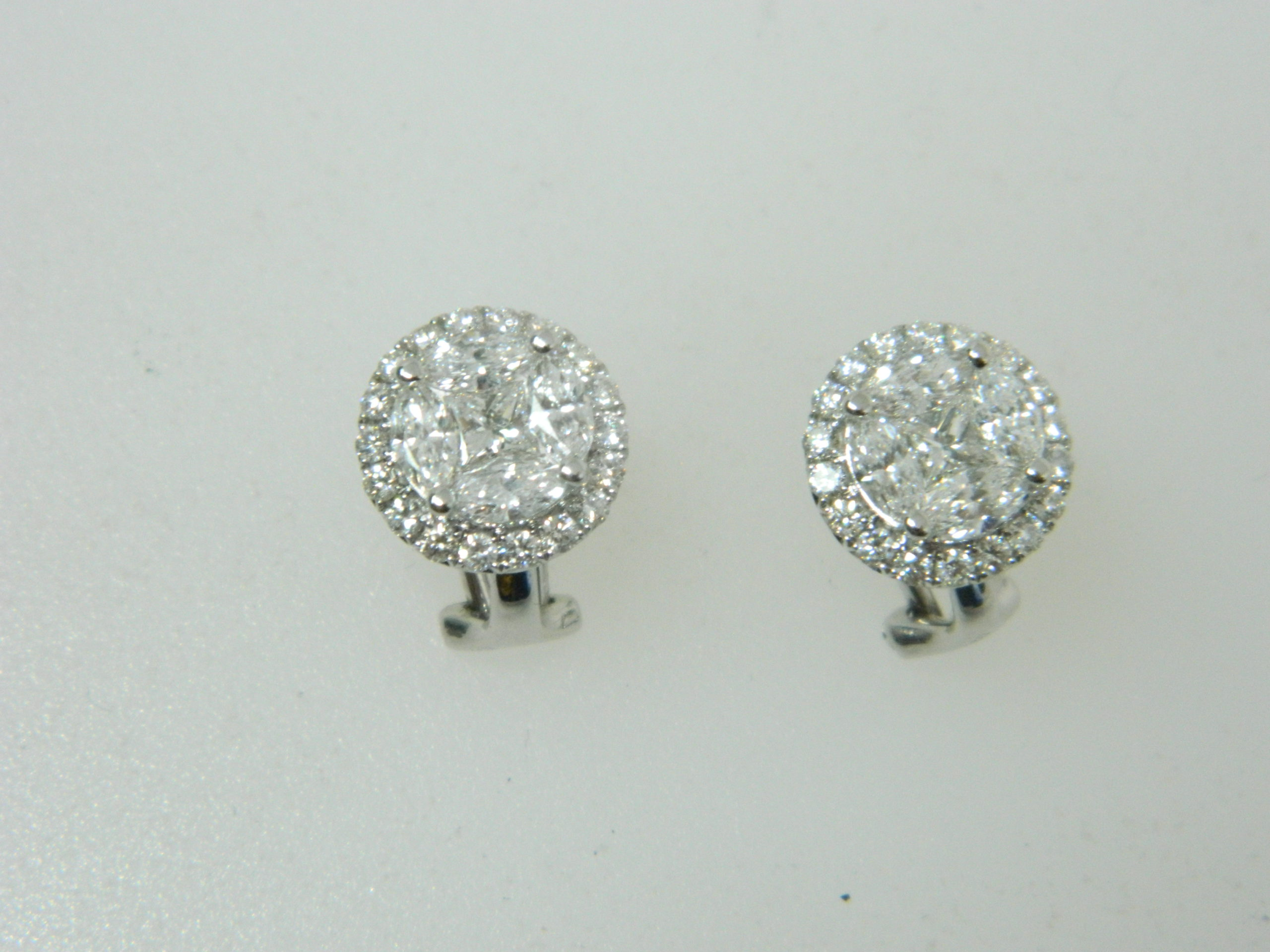 18 Karat White Gold Button Mounted Earrings with 8 Marquise Cut Diamonds weighing 1.08cts, 2 Princess Cut Diamonds weighing 0.37cts, 36 Round Cut Diamonds weighing 0.55cts.