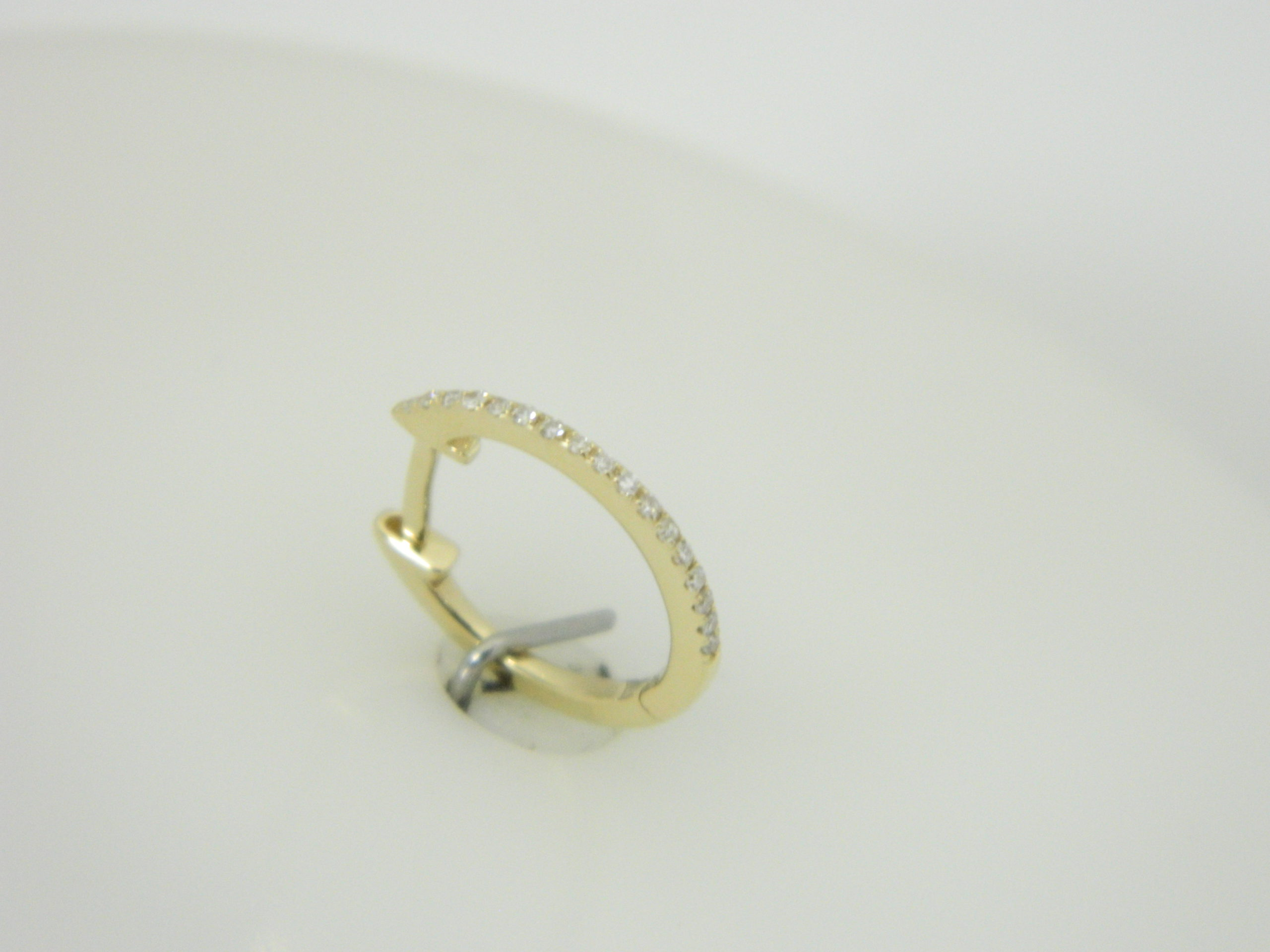 14 Karat Yellow Gold Hoop Mounted Earrings with 34 Round Cut Diamonds weighing 0.09ct tw. Diamond half way around.