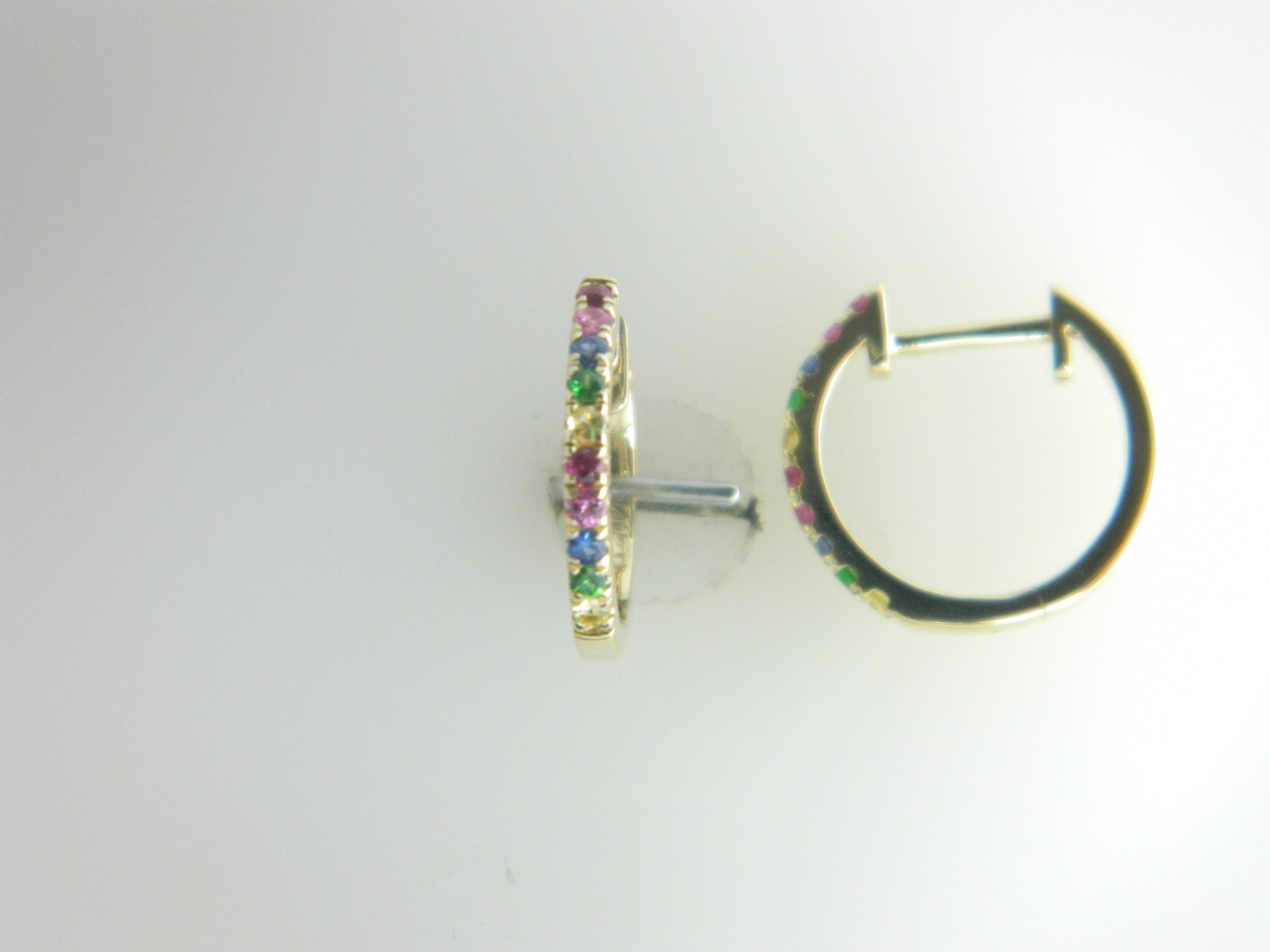 14 Karat Yellow Gold Hoop Mounted Earrings with 4 Sapphire 0.03ct, 4 Pink Sapphires 0.03ct, 4 Rubies 0.03ct, 4 Multi-Color Sapphires 0.03ct and 4 Green Garnets 0.03ct tw.