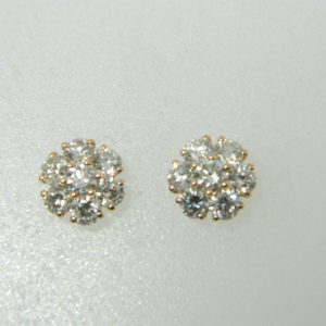 14 Karat Rose Gold Stud Mounted Earrings with 14 Round Cut Diamonds weighing 1.50cts.