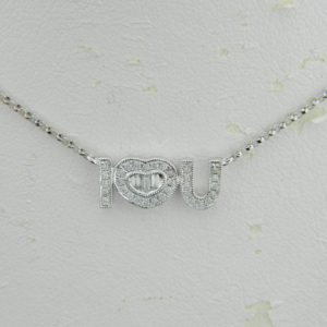 18 Karat White Gold Mounted Necklace with 3 baguette cut diamonds weighing 0.07ct and 32 round diamonds weighing 0.14ct