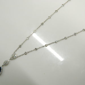18 Karat White Gold Mounted Necklace with 1 Pear Shaped Blue Sapphire weighing 1.48cts, 1 Marquise Cut Diamond weighing 0.13cts, 79 Round Cut Diamonds weighing 1.08cts, 1 Pear Shaped diamond weighing 0.31cts.