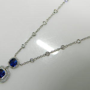 18 Karat White Gold Mounted Necklace with 2 Blue Sapphires weighing 1.88cts, 30 Round Cut DIamonds weighing 0.74cts, 68 Round Cut Diamonds weighing 0.30cts.