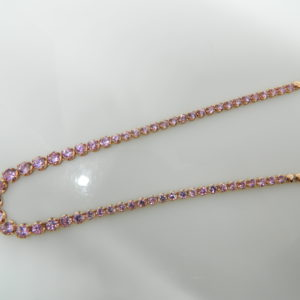 "14 Karat Rose Gold Mounted 16.5"" Necklace with 57 Round Cut Pink Sapphires weighing 5.17cts, half way around"