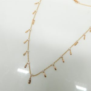 "18 Karat Rose Gold Mounted 16-18"" Necklace with 15 Round Cut Diamonds weighing 0.58cts."