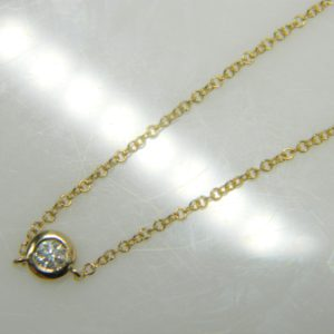 "14 Karat Yellow Gold Mounted 18"" Necklace with 1 Round Cut Bezel Set Diamond weighing 0.10cts."
