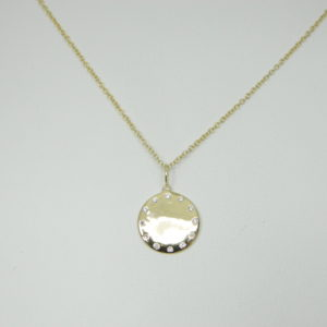 14 Karat Yellow Gold Disc Mounted 18'' Necklace with 12 Round Cut Diamonds weighing 0.09ct tw.