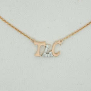 "14 Karat Rose Gold Mounted ""TLC"" Necklace with 9 round diamonds weighing 0.04ct"