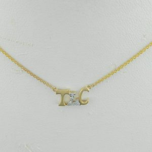 "14 Karat Yellow Gold Mounted ""TLC"" Necklace with 9 round diamonds weighing 0.04ct"