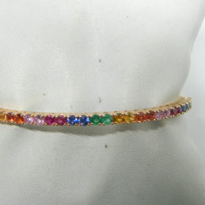 14 Karat Rose Gold Bangle Mounted Bracelet with 32 Multi-Colored Round Sapphires weighing 2.84cts.