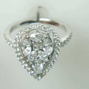 18 Karat White Gold Trendy Ring with 9 Marquise and Princess Cut Diamonds weighing 0.75cts & 41 Round Cut Diamonds weighing 0.46cts, 1 Pear Shaped Diamond weighing 0.23cts - Size 6.5