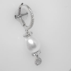 14 Karat White Gold Pearl Mounted Earrings with 110 Round Cut Diamonds weighing 0.32cts & 2 Pearls 8x9mm