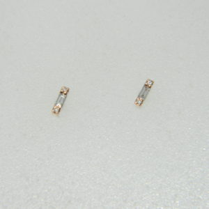14 Karat Rose Gold Stud Mounted Earrings with  4 Round Cut Diamonds Weighing 0.01cts, and 2 Baguettes Weighing 0.03cts.