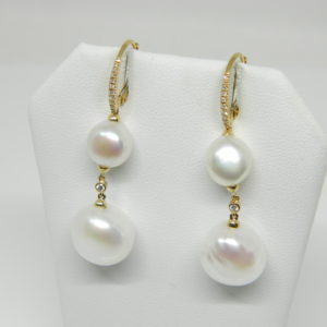 14 Karat Yellow Gold Pearl Mounted Earrings with 22 Round Cut Diamonds weighing 0.10cts & 4 Pearls