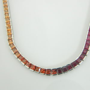 14 Karat White Gold Mounted 18'' Necklace with 100 Princess Cut Multi-Color Sapphires weighing 20.23cts tw.